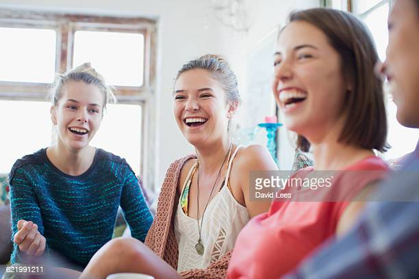 Women laughing and relaxing in living room