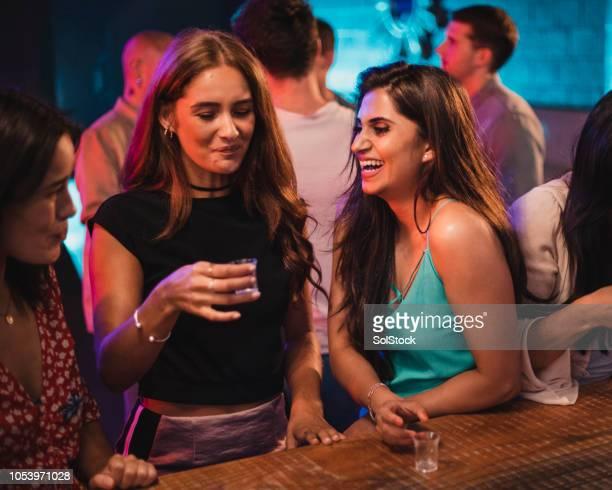 women laughing at her friends taking shots - atirar à baliza imagens e fotografias de stock