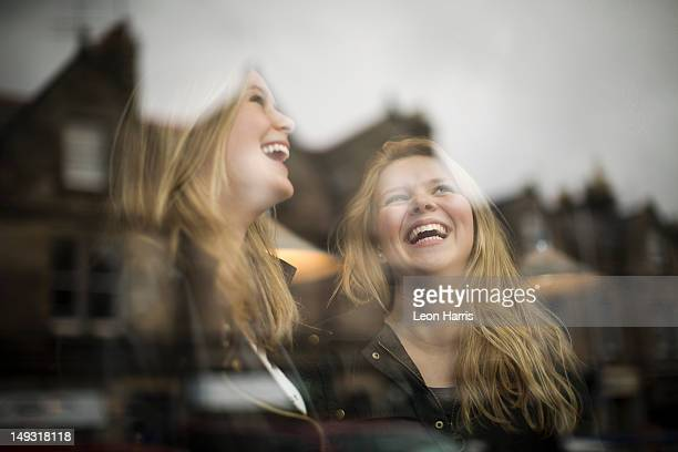 women laughing at window - st. andrews scotland stock pictures, royalty-free photos & images