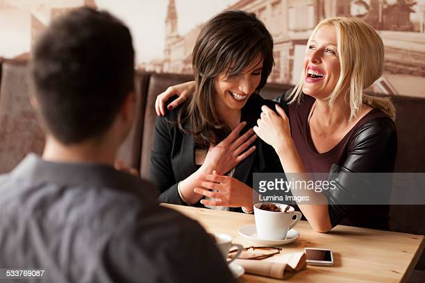 Women laughing in cafe