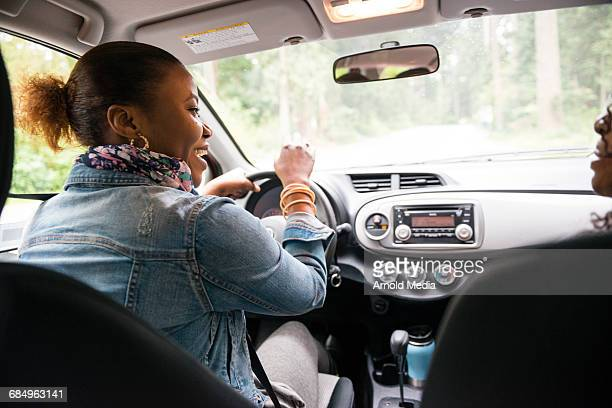 women laughing in car while driving - family inside car stock photos and pictures