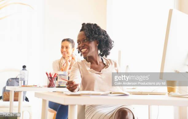 Women laughing in office