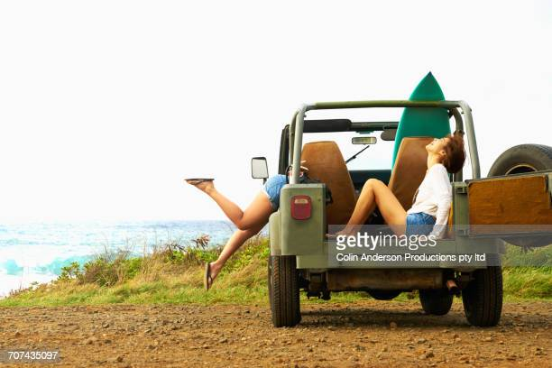 women laughing in off-road vehicle - beautiful asian legs stock photos and pictures
