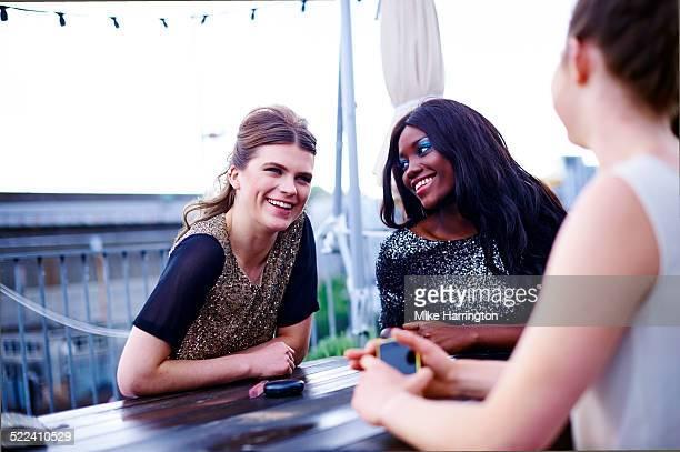 Women laughing in rooftop garden
