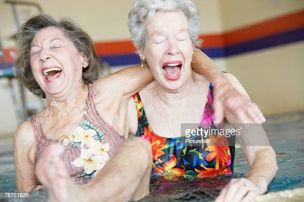 Women Laughing in Swimming Pool