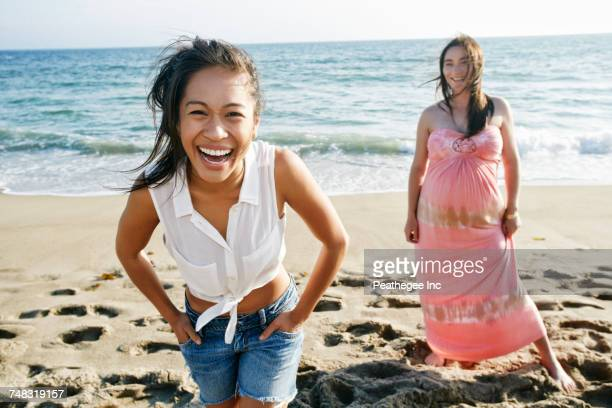 women laughing on beach - pretty vietnamese women stock pictures, royalty-free photos & images