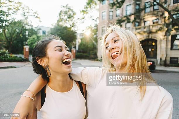 Women laughing on street