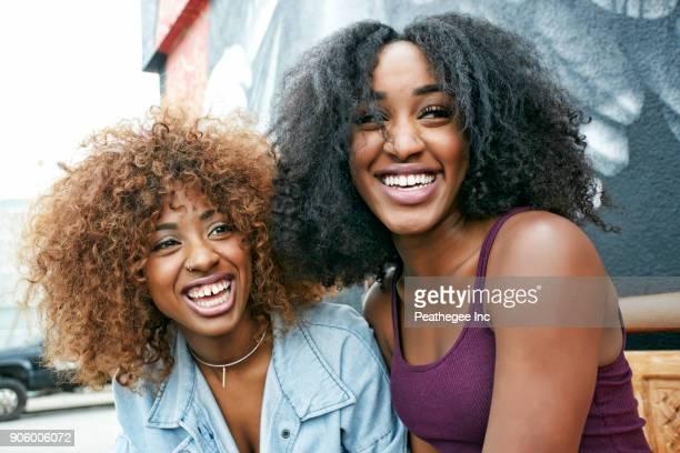 women laughing outdoors - zus stockfoto's en -beelden