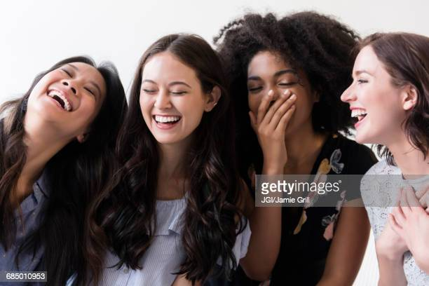 women laughing - multiculturalism stock pictures, royalty-free photos & images
