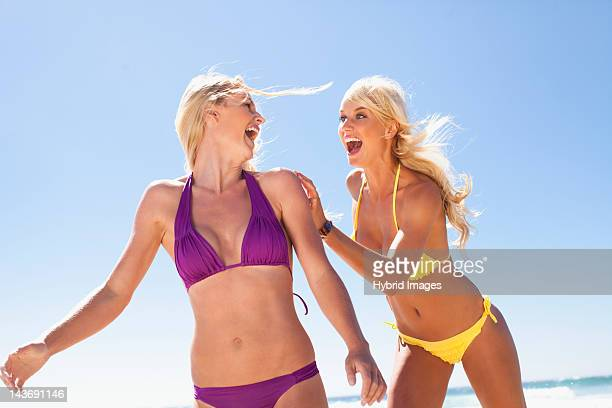Women laughing together on beach