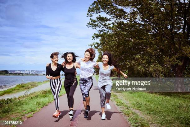 women leaders running outdoors - 4人 ストックフォトと画像
