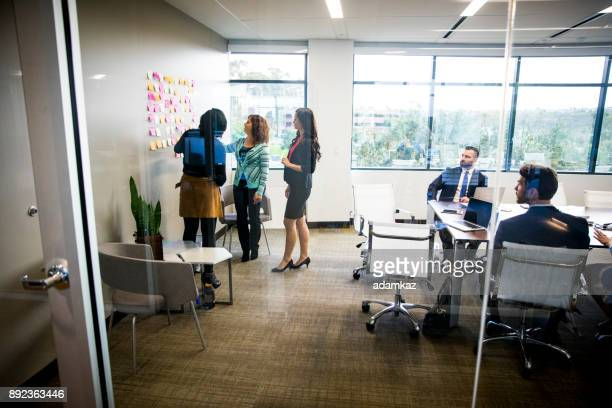 women leading the meeting - flexibility stock pictures, royalty-free photos & images