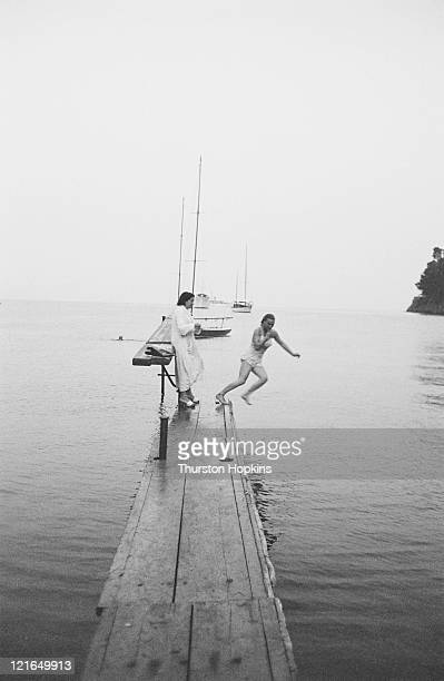 Women leaping into the sea from a jetty on Paraggi Beach near the tourist resort of Portofino Italy August 1952 Original Publication Picture Post...