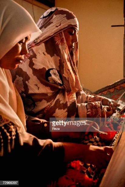 Women learn to make carpets in a weaving workshop on April 2000 in Ghadames Libya
