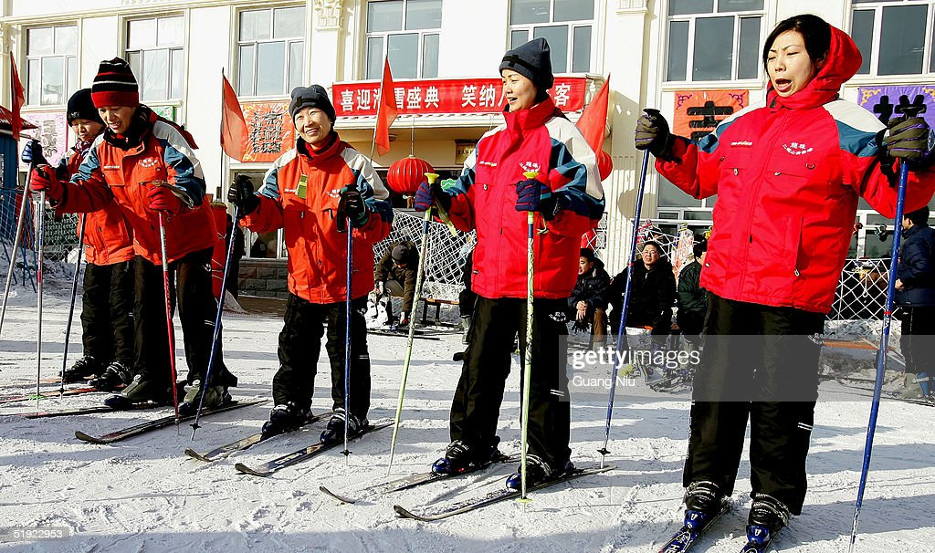 Women learn to ski at a skiing resort on January 7, 2005 in Harbin, China. Local authorities are preparing to bid for the 2014 Winter Olympic Games despite losing the bid to host the 2010 winter games.