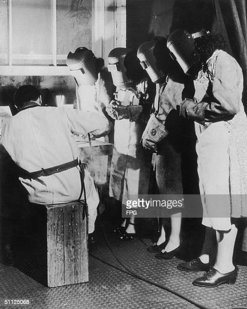 Women learning to weld circa 1940