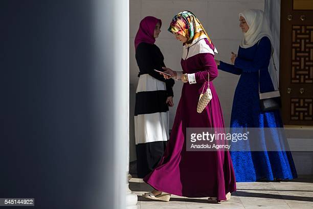 Women leave the mosque after the Eid alFitr prayer at the Diyanet Center of America to mark the end of the Muslims' holy fasting month of Ramadan in...