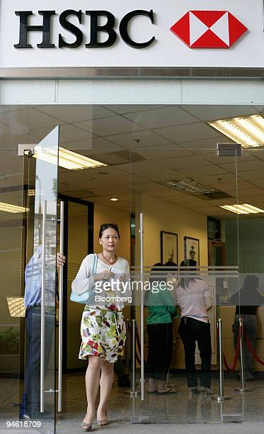 A women leaves a branch of HSBC in Hanoi Vietnam on Tuesday August 22 2006