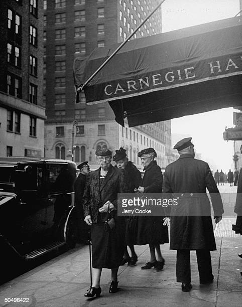 Women leaving Carnegie Hall after the afternoon concert.