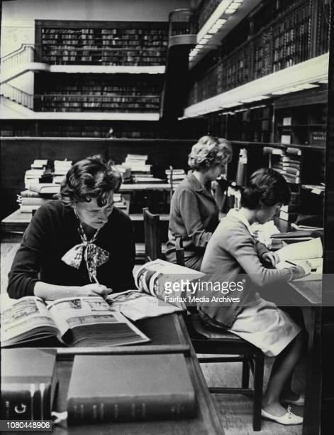 Women Librarians Miss Diana Drake of Turramurra Miss Jennifer Affleck of Pymble and Miss Cathy Lynch of Kingsford looking up information in the...