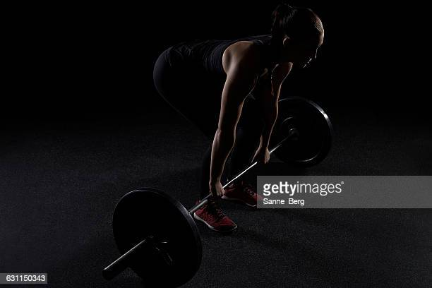 Women lifting a barbell in the gym