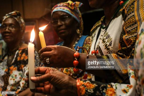 Women light candles during a tribute to social leaders murdered in Colombia in Medellin on January 31 2018 According to the Public Prosecutor's...