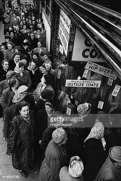 Women line up for the opening sale at Evans the Outsize Shop on Walworth Road in Southwark London England UK in 1952 Evans specializes in selling...
