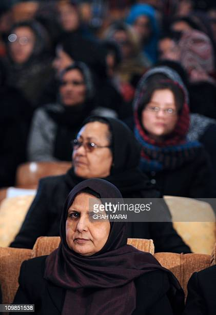 Women listen as an unseen Afghan President Hamid Karzai addresses a gathering of women to mark International Women's Day at Amani High School in...