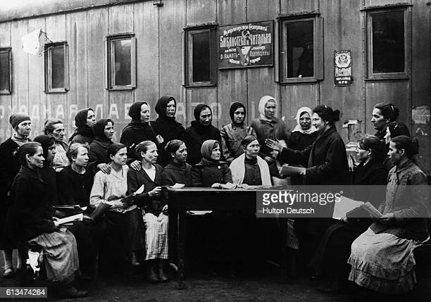 Women listen carefully as their instructor gives them information about their work on the Russian railroads