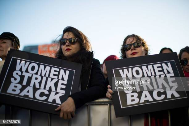 Women listen to speaks as they attend a rally to mark International Women's Day in Washington Square Park March 8 2017 in New York City Thousands of...