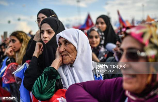 Women listen to the Turkish President and leader of the Justice and Development Party as he gives an address to his supporters during the AKP rally...