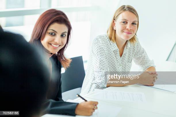 Women listening at conference table