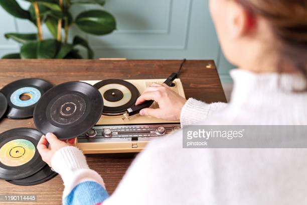 women listening to music with retro turntable on table - record analog audio stock pictures, royalty-free photos & images