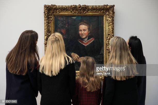Women look at a portrait of suffragist Millicent Fawcett by British artist Annie Swynnerton circa 1899 during a photocall at Tate Britain on February...