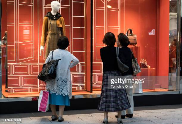 Women look at a window display outside a store in the Ginza shopping district on September 22, 2019 in Tokyo, Japan. Japanese consumers are preparing...
