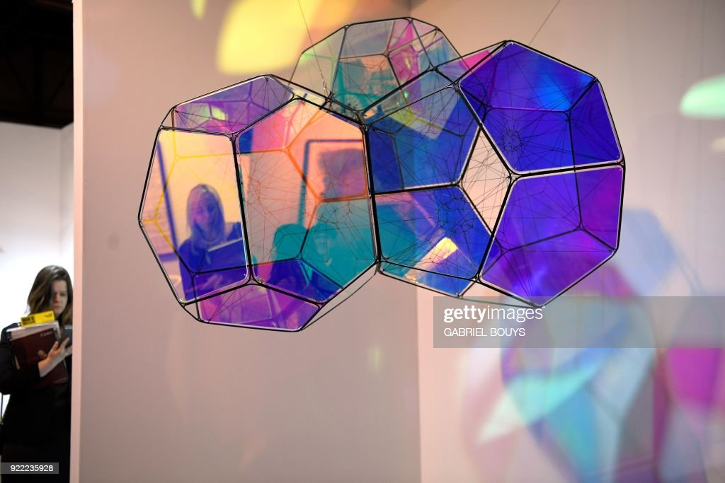 Women look at an installation by Argentinian artist Tomas Saraceno during the ARCO International Contemporary Art Fair opening in Madrid on February 21, 2018. Madrid hosts the annual Arco contemporary art fair, one of Europe's biggest, from February 21 to February 25, 2018. /
