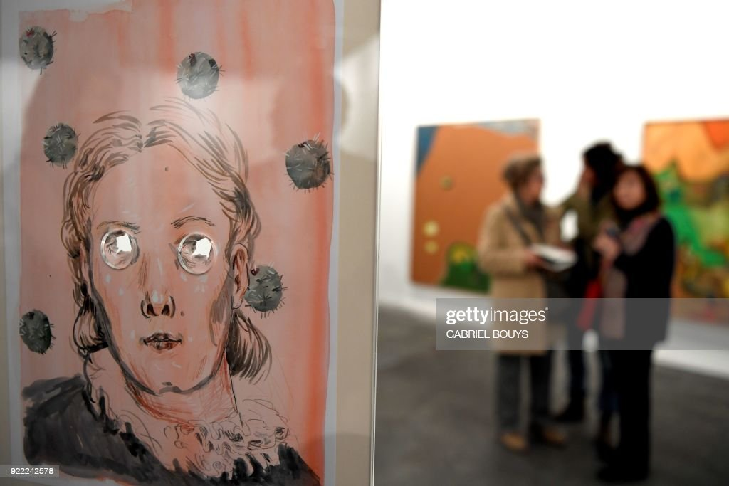 Women look at an untitled installation by Spanish artist Guillermo Mora Perez during the ARCO International Contemporary Art Fair opening in Madrid on February 21, 2018. Madrid hosts the annual Arco contemporary art fair, one of Europe's biggest, from February 21 to February 25, 2018. /