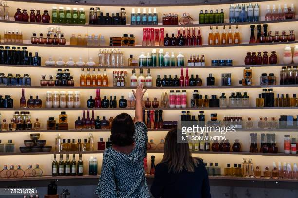 Women look at cosmetic products on display at the plant of Brazilian cosmetics company Natura, in Cajamar, some 43 km from Sao Paulo, Brazil on...
