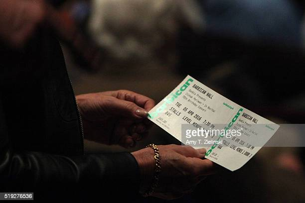 Women look at her ticket before IsraeliAmerican virtuoso violinist Itzhak Perlman celebrates his 70th birthday with a concert featuring the...