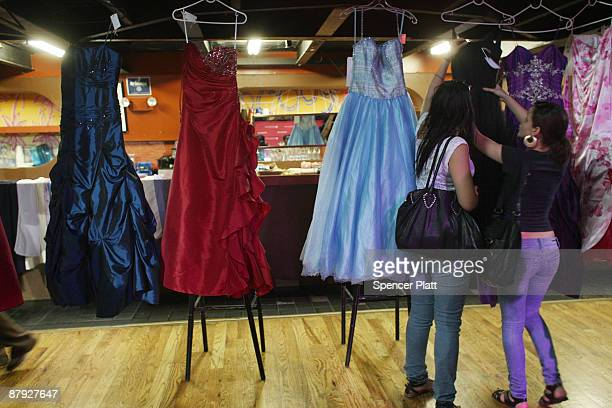 Women look at prom dresses at Project Prom an event offering free dresses handbags shoes and accessories to high school students on May 22 2009 in...