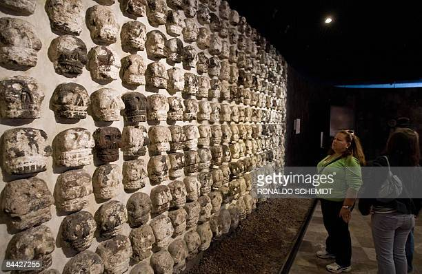 Women look at skull sculptures inside the 'Templo Mayor' Museum in Mexico City on January 23 2009 The 'Templo Mayor' museum is located next to the...