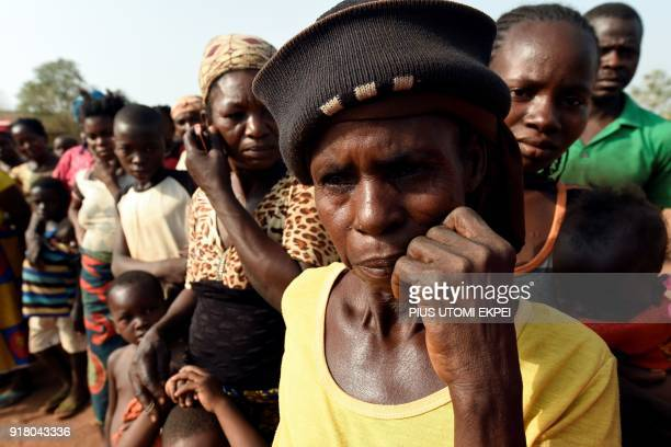 Women look on at the internally displaced people camp occupied largely by women and children affected by herders and farmer's violent clashes from...