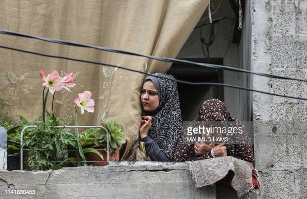 Women look on during the funeral ceremony of five Palestinians, who were killed in Israeli strikes the previous day, in Beit Lahia, in northern Gaza...