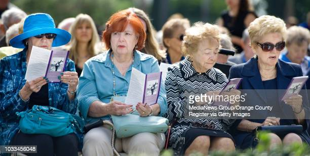 Women look over the memorial program for Rev. Robert H. Schuller. Outside Christ Cathedral in Garden Grove Monday. ///ADDITIONAL INFORMATION: Ð...