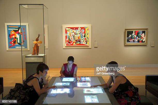 Women looking at a touch screen in the Museum of Fine Arts