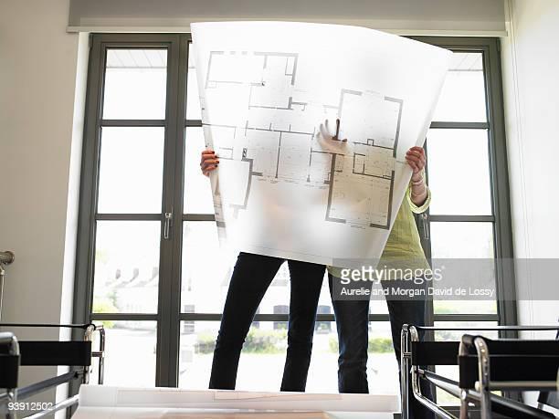 women looking at blueprint