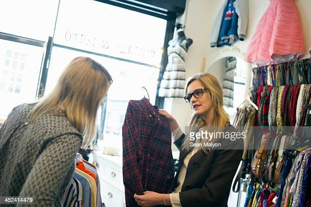 women looking at checked shirt - sean malyon stock pictures, royalty-free photos & images