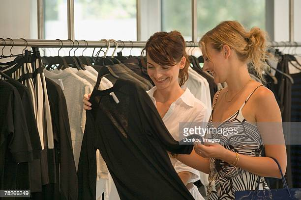 Women looking at clothes on display at a boutique.
