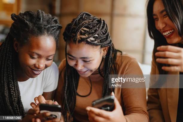 Women looking at phone using Internet dating app