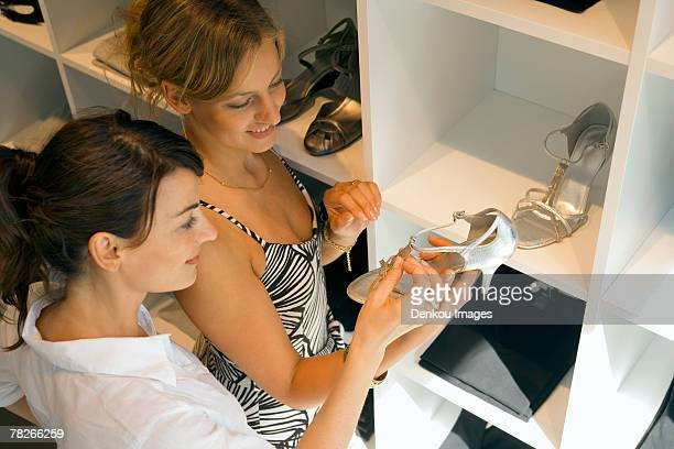 Women looking at shoes at shoe store.